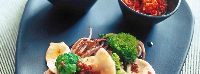 Black polenta with squid, oil and broccoli