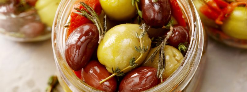 How are natural olives seasoned?