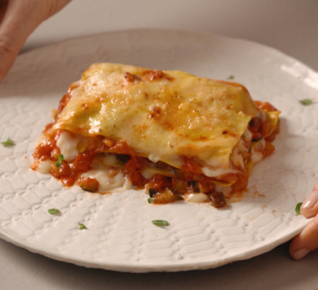 Lasagna with vegetable sauce with smoked sauce and smoked cheese