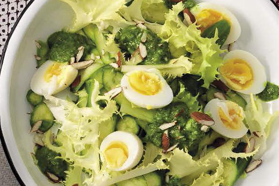 Salad, quail eggs and green sauce